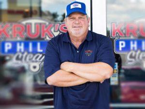 john kruk in front of store